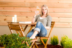 Garden woman wine enjoy rest terrace. Garden happy woman enjoy wine rest terrace Stock Photos