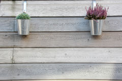 Garden wood background with metal pots Royalty Free Stock Photos