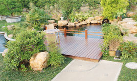Garden with wood pergola and pond. A private garden with wood pergola over a fish pond,tropical resort Stock Photography