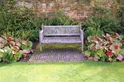 Garden wooden bench or seat Stock Photos