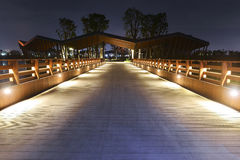 Garden wooden bridge illuminated by led light. Decorative led light used on garden bridge at night stock photography