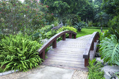 Garden wooden plank bridge Stock Photo