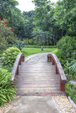 Garden wooden plank bridge Royalty Free Stock Image