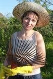 Garden work. Portrait of woman with fan royalty free stock image