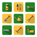 Garden work tools. Vector icons set of garden work tools: secateurs, spray, watering can, shovel, rake, fork, saw. Vector flat style illustration with shadow Stock Photography