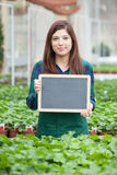 Garden worker with chalkboard Royalty Free Stock Photo