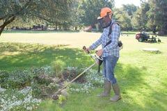 Garden worker doing job stock images