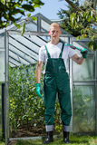 Garden worker standing in front of glasshouse Royalty Free Stock Photography