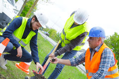 Garden workers digging in park. Garden workers are digging in a park Royalty Free Stock Images