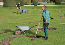 Garden workers are digging in park of Vienna, Austria Royalty Free Stock Photography