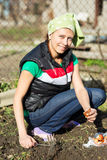 Garden Works. Young Woman Working in the Garden. Healthy Lifesty Stock Photos