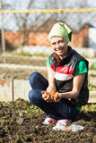 Garden Works. Young Woman Working in the Garden. Healthy Lifesty Stock Photography