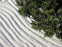 Garden zen. A zen garden with raked sand Stock Photo