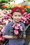 Gardener. 7 years old boy in his flower garden - kids and family royalty free stock photo