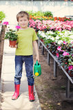 Gardener. 7 years old boy in his flower garden - kids and family stock image