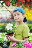 Gardener. 7 years old boy in his flower garden - kids and family royalty free stock photos