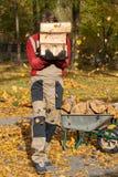 Gardener carring logs Stock Photography