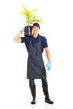 Gardener carrying plant Stock Photos