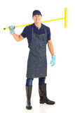 Gardener carrying rake Stock Photo
