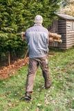 Gardener carrying wood Royalty Free Stock Photos