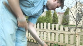 The gardener digs in the garden. HD stock video footage