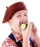 Gardener eating green cucumber Royalty Free Stock Photos