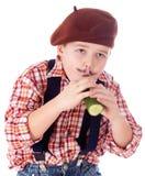 Gardener eating green cucumber Royalty Free Stock Image
