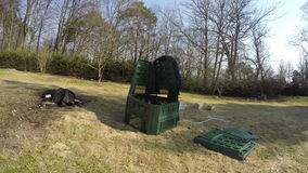 Gardener farmer man assemble plastic compost box. Timelapse. 4K. Gardener farmer man assemble plastic compost box on dry spring meadow. Preparing container for stock video footage