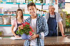 Gardener and florist as staff in nursery shop. At the checkout counter royalty free stock image