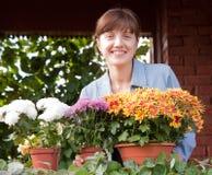 Gardener with flowers on the balcony Stock Photo