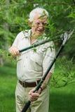 Gardener with garden shears Royalty Free Stock Image