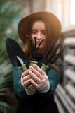Gardener with garden tools in hands. Royalty Free Stock Photos