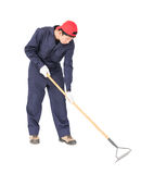 Gardener with garden tools on white Royalty Free Stock Photography