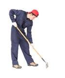 Gardener with garden tools on white Stock Photo