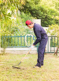 Gardener with garden tools at work Royalty Free Stock Images