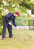 Gardener with garden tools at work Royalty Free Stock Photography