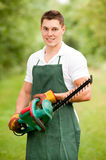 Gardener with hedge trimmer Royalty Free Stock Photos