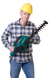 Gardener with hedge trimmer Royalty Free Stock Images