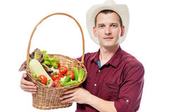 Gardener with his harvest of organic vegetables in the basket Stock Photos