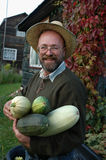 Gardener holding large marrows stock photo