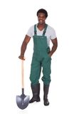 Gardener holding shovel Stock Images