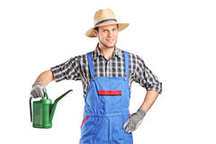 Gardener holding a watering can Stock Photo