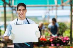 Gardener holding white board Stock Photos