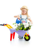 Gardener kid watering flowers Royalty Free Stock Photo
