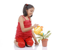 Gardener little girl watering plant Stock Photos