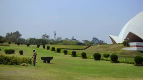 Gardener man spring cleaning the Lotus Temple Garden New Delhi India stock video footage