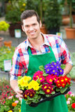 Gardener in market garden or nursery Royalty Free Stock Photos