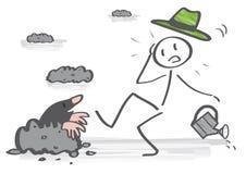 Gardener and a mole. Gardener discovers a mole in his garden stock illustration