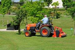 Gardener mowing lawn, Alrewas, UK. Royalty Free Stock Photos