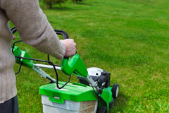 Gardener mowing the lawn Royalty Free Stock Photography